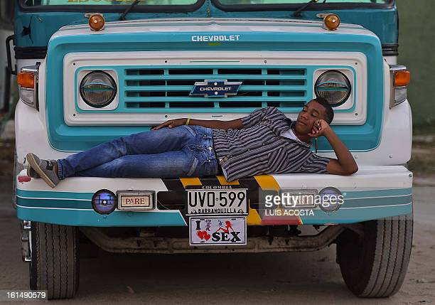A driver rests as he waits for dancers during the third day of carnival in Barranquilla Colombia on February 11 2013 Barranquilla's Carnival a...