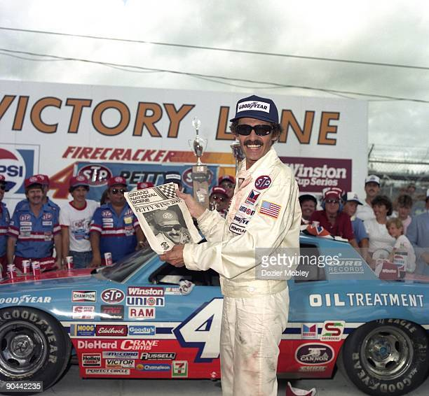 Driver Richard Petty celebrates in Victory Lane after winning his 200th and final career race at the Firecracker 400 race on July 4 1984 at the...