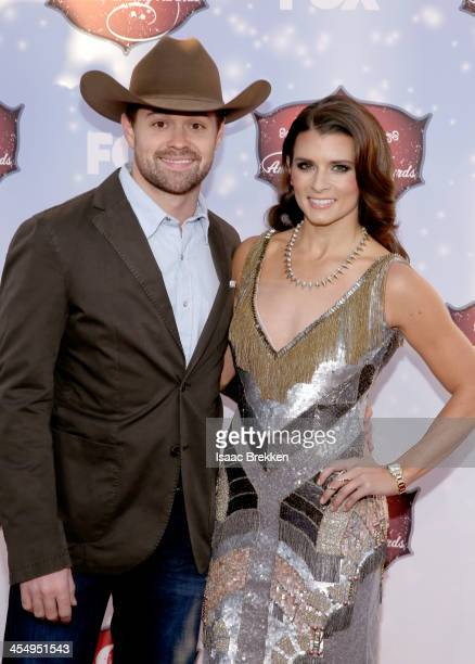 Driver Ricky Stenhouse Jr and cohost Danica Patrick arrive at the American Country Awards 2013 at the Mandalay Bay Events Center on December 10 2013...