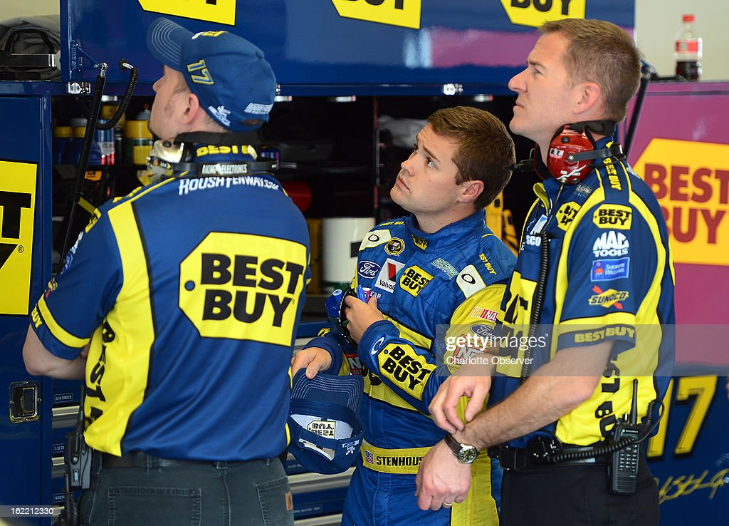 NASCAR driver Ricky Stenhouse Jr. and members of his team look over computer data following practice laps on Wednesday, Febraury 20, 2013, at Daytona International Speedway in Daytona Beach, Florida.