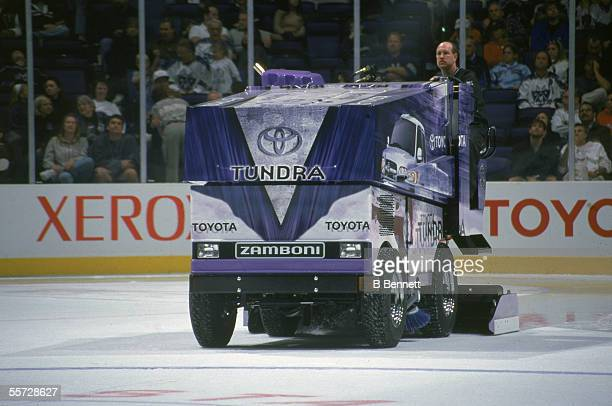 A driver rides a Zamboni ice resurfacer advertising the Toyota Tundra around the rink during downtime of an LA Kings game at the Staples Center Los...
