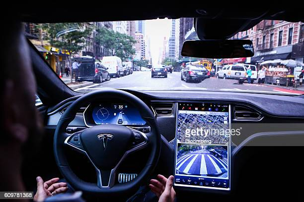 A driver rides handsfree in a Tesla Motors Inc Model S vehicle equipped with Autopilot hardware and software in New York US on Monday Sept 19 2016...