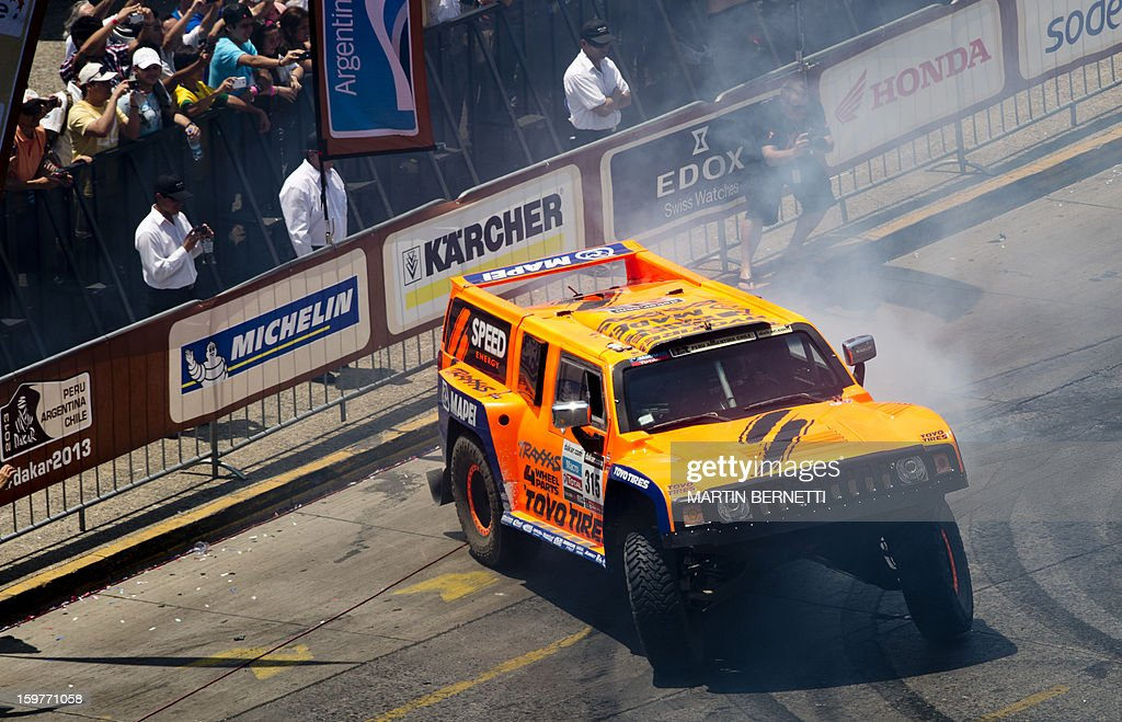 US driver Robby Gordon performs during the 2013 Dakar Rally podium ceremony, in Santiago, Chile, on January 20, 2013. Stephane Peterhansel claimed a record fifth Dakar Rally drivers title, and 11th overall of his career, while French compatriot Cyril Despres captured a fifth motorcycling crown.