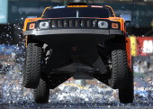 US driver Robby Gordon steers his Hummer with codriver Andy Grider during the symbolic start of the Dakar 2011 Rally in downtown Buenos Aires on...