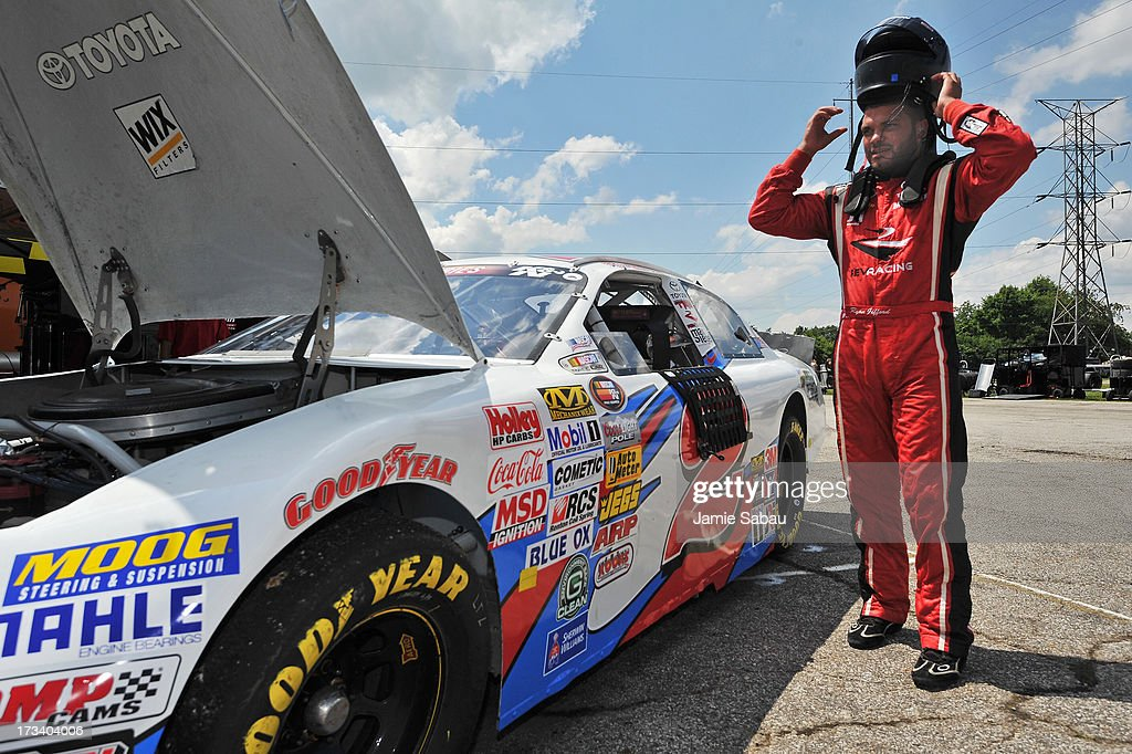 Driver Ryan Gifford takes off his helmet after practice for the NASCAR K&N Pro Series, East NAPA 150 on July 13, 2013 at Columbus Motor Speedway in Columbus, Ohio.