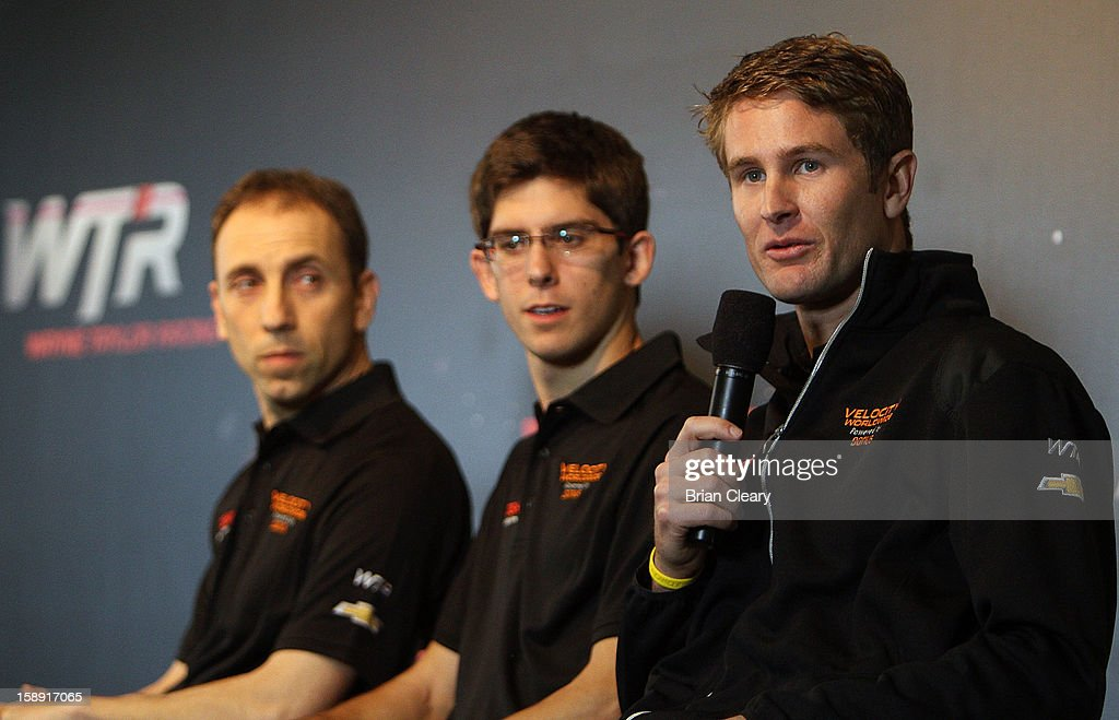Driver Ryan Hunter-Reay, right, addresses the media at a press conference announcing Velocity Worldwide as the new sponsor for the #10 Wayne Taylor Racing Corvette Dallara DPas co-drivers Max Angelelli, left and Jordan Taylor look on at Daytona International Speedway on January 3, 2013 in Daytona Beach, Florida.