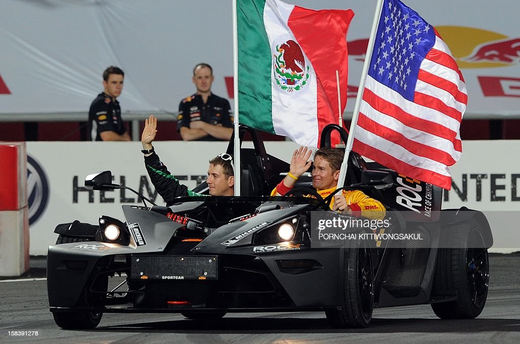 US driver Ryan Hunter-Reay (R) sits next to Benito Guerra of Mexico (L) during the Race of Champions (ROC) Nations Cup Drivers 's Presentation at Rajamangala Stadium in Bangkok on December 15, 2012. The Race of Champions (ROC) will take place in Thailand between December 14 and 16 and brings together heavyweights from all motor racing disciplines in the same type of car.