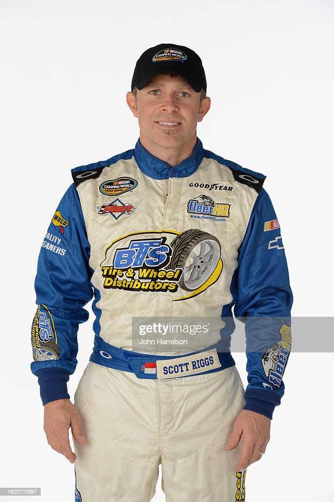 Driver Scott Riggs poses during portraits for the 2013 NASCAR Camping World Truck Series at Daytona International Speedway on February 21 2013 in...