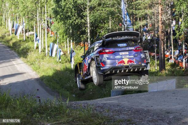 Driver Sebastien Ogier of France and his codriver Julien Ingrassia of France steer their Ford Fiesta WRC during the 3rd stage Urria of the Neste...