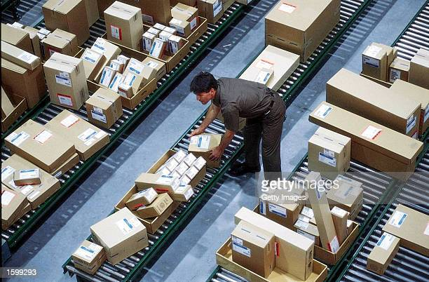 PHOTO A driver sorts packages in the hub at a United Parcel Service facility in an undated photo UPS announced November 8 2002 that it is raising...