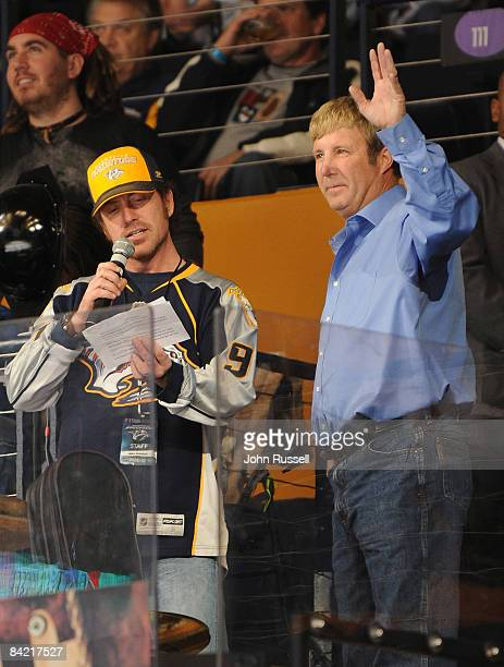 NASCAR driver Sterling Marlin waves to fans during a timeout of the Nashville Predators and Pittsburgh Penguins game on January 8 2009 at the Sommet...