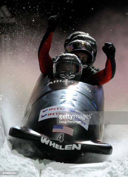 Driver Steven Holcomb of the USA and his crew celebrate after their second run as they finished second in the men's four man bobsleigh finals at the...