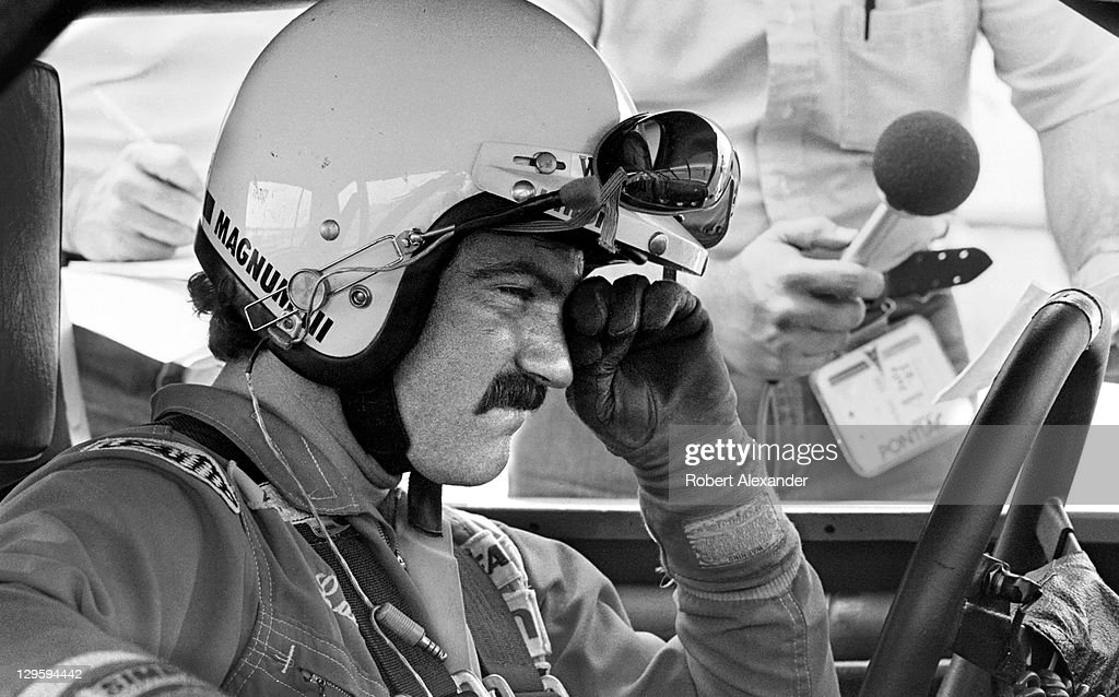 NASCAR driver Terry Labonte is interviewed by broadcaster Jerry Punch prior to the start of the 1983 Firecracker 400 at the Daytona International...