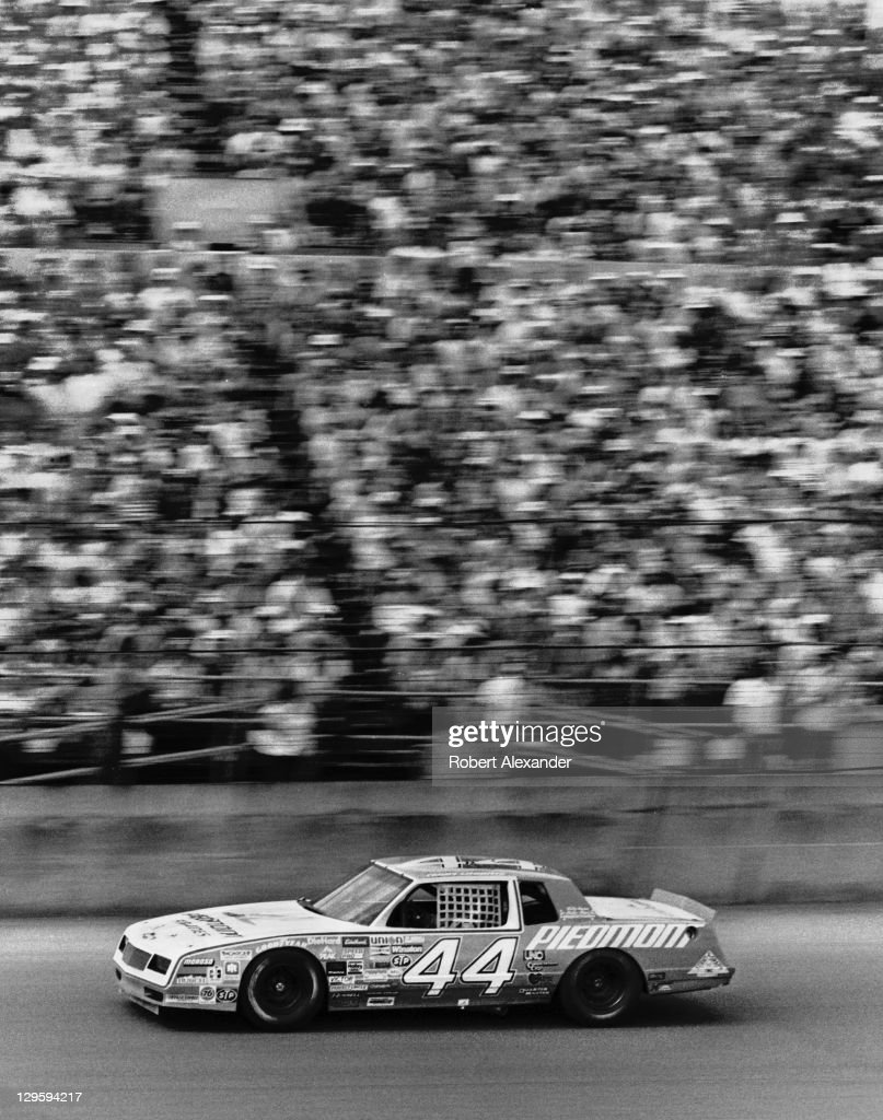 NASCAR driver Terry Labonte speeds past the grandstands at the Daytona International Speedway during the 1984 Daytona 500 on February 19 1984 in...