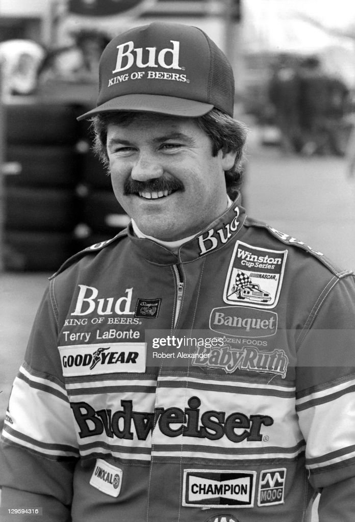 NASCAR driver Terry Labonte strolls through the garage area at Daytona International Speedway prior to the start of the 1987 Daytona 500 on February...