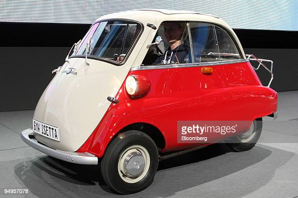 A driver tests a vintage BMW Isetta automobile prior to the opening of the Frankfurt Motor Show in Frankfurt Germany on Monday Sept 14 2009...