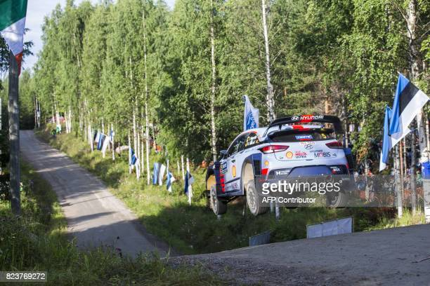 Driver Thierry Neuville of Belgium and his codriver Nicolas Gilsoul of Belgium steer their Hyundai i20 Coupe WRC during the 3rd stage Urria of the...