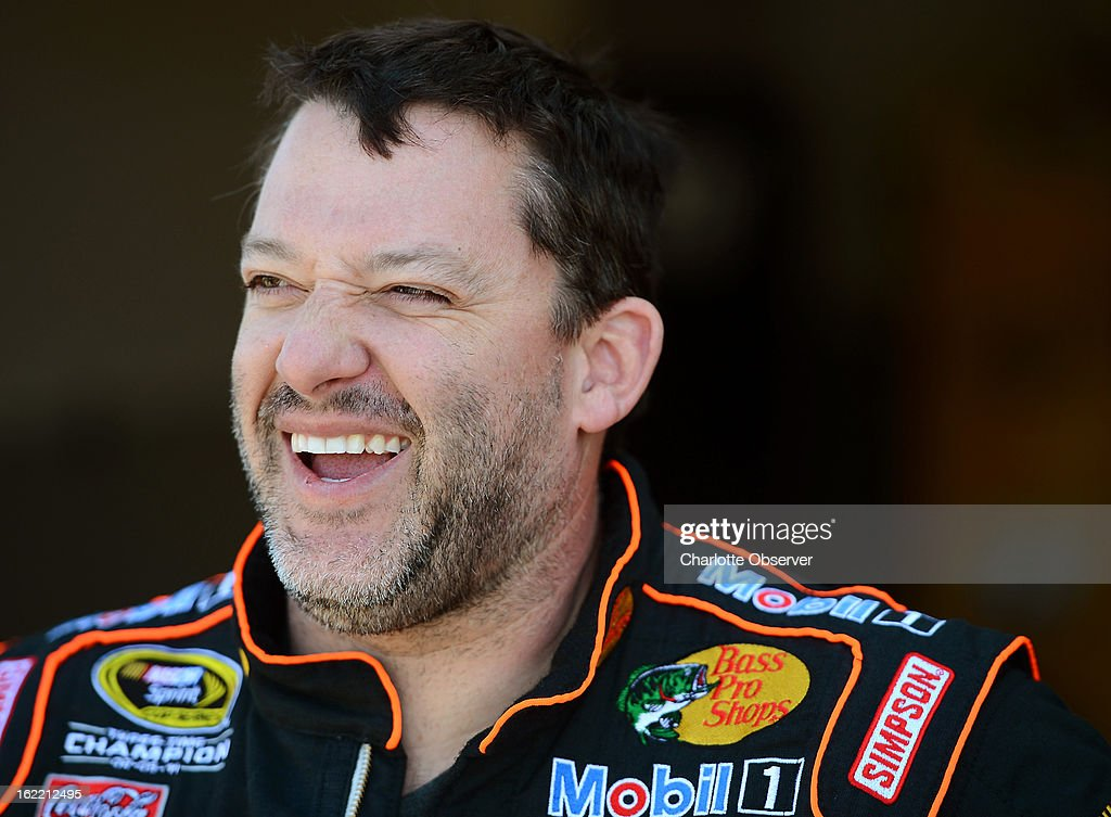 NASCAR driver Tony Stewart enjoys a laugh following practice laps on Wednesday, Febraury 20, 2013, at Daytona International Speedway in Daytona Beach, Florida.