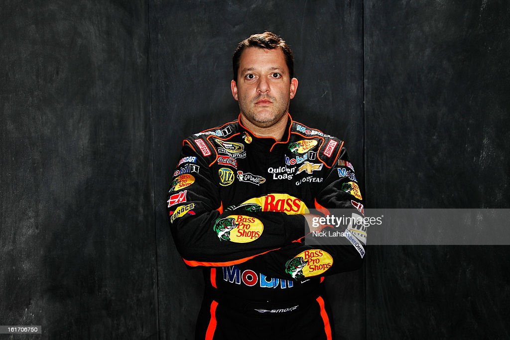 Driver <a gi-track='captionPersonalityLinkClicked' href=/galleries/search?phrase=Tony+Stewart+-+Race+Car+Driver&family=editorial&specificpeople=201686 ng-click='$event.stopPropagation()'>Tony Stewart</a> poses during portraits for the 2013 NASCAR Sprint Cup Series at Daytona International Speedway on February 14, 2013 in Daytona Beach, Florida.
