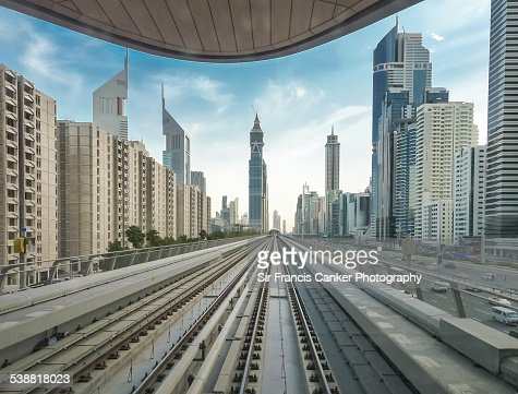 Driver POV of tracks with Dubai cityscape, UAE
