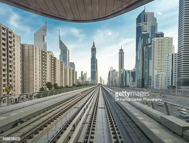 Driver POV of tracks with Dubai cityscape, UAE