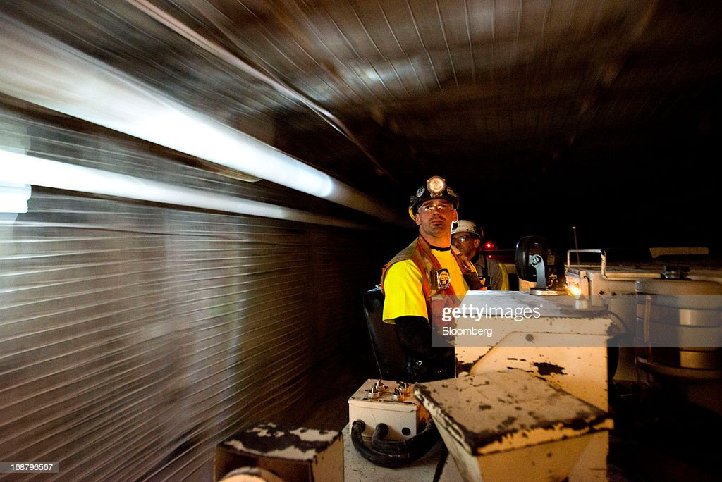 A driver transports coal in the longwall mining tunnel at the Consol Energy Bailey Mine in Wind Ridge, Pennsylvania, U.S., on Tuesday, May 14, 2013. Coal's prospects are improving after its share of U.S. power generation fell last year to 34 percent, the lowest since at least 1973, Energy Department data show. Hotter temperatures this summer that prompt American households to use more air conditioning will boost demand for coal and the railroads that ship it. Photographer: Ty Wright/Bloomberg via Getty Images