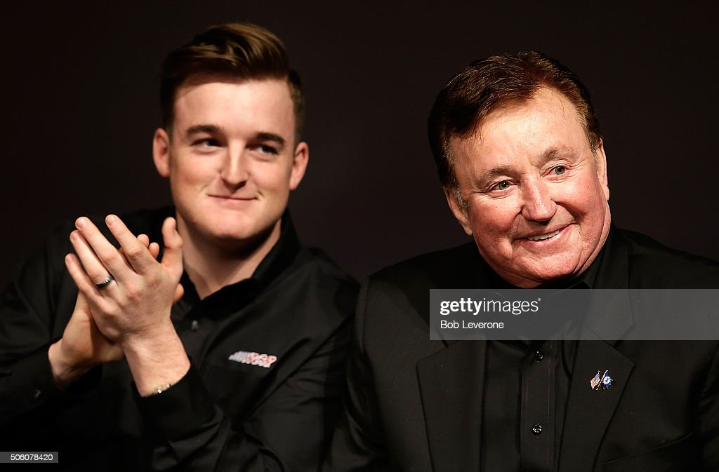 Driver Ty Dillon applauds as car owner Richard Childress smiles during the NASCAR 2016 Charlotte Motor Speedway Media Tour on January 21 2016 in...