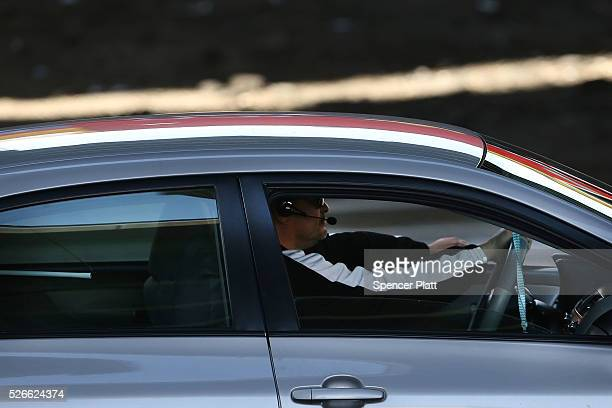 A driver uses a legal headset while behind the wheel of a car on April 30 2016 in New York City As accidents involving drivers using phones or other...