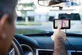 Driver using GPS for navigational assistance