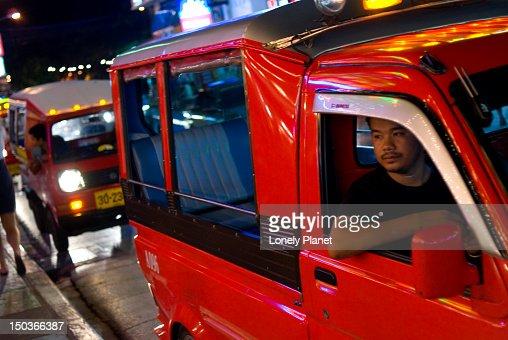 Driver waiting for customers along Thanon Bangla.