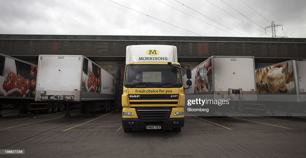 A driver waits in his cab as his trailer is loaded produce ahead of transporting to a supermarket, at WM Morrison Supermarkets Plc's distribution center in Wakefield, U.K., on Thursday, Nov. 22, 2012. Britain's economy will return to growth next year after stagnating in 2012, with expansion weighted in the second half, according to Bank of England projections published yesterday. Photographer: Simon Dawson/Bloomberg via Getty Images