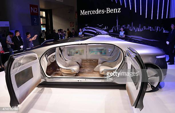 A driverless car from MercedesBenz is seen on display during the first Consumer Electronics Show in Asia in Shanghai on May 26 2015 More than 200...
