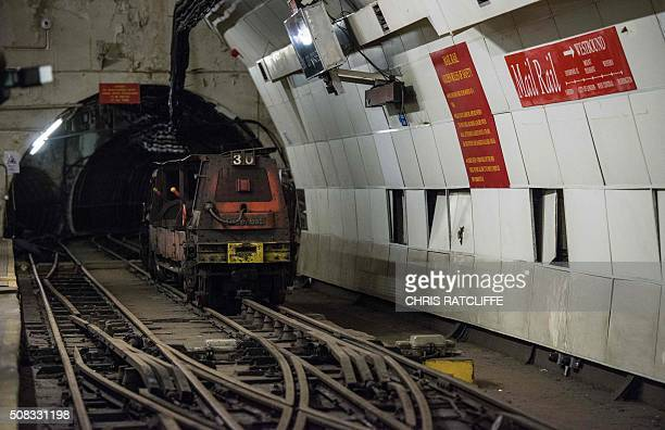 A driverless train sits on the underground tracks of the Mail Rail the old rail system that transported mail between sorting offices as work starts...