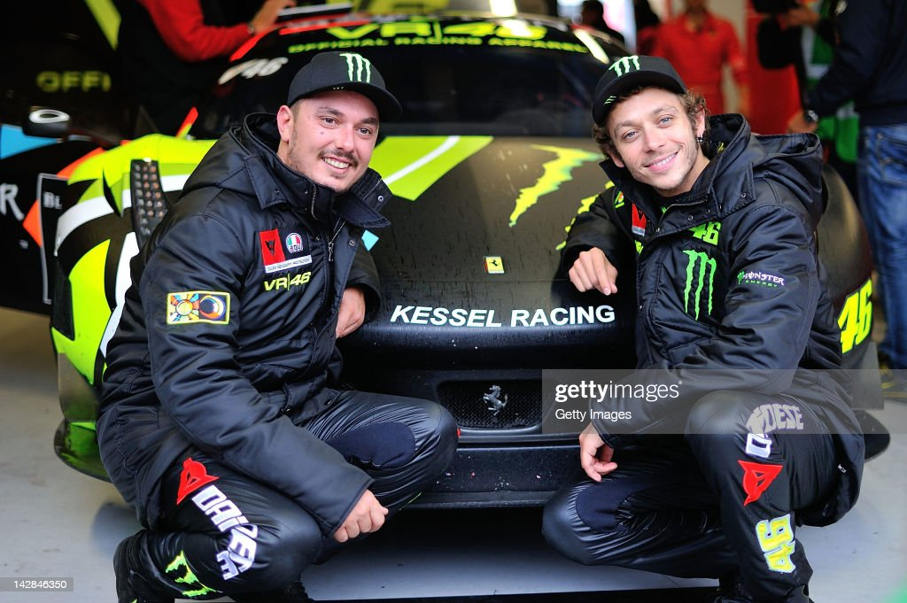 Drivers Alessio 'Uccio' Salucci (L) and Valentino Rossi of Team Kessel Racing - Ferrari 458 Italia pose for photographers during the Blancpain GT Endurance test day one at Autodromo di Monza on April 13, 2012 in Monza, Italy.