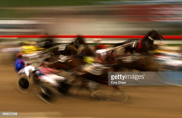 Drivers and horses compete in race four of harness racing at Harold Park on December 5 2008 in Sydney Australia Harold Park opened in 1902 and in...