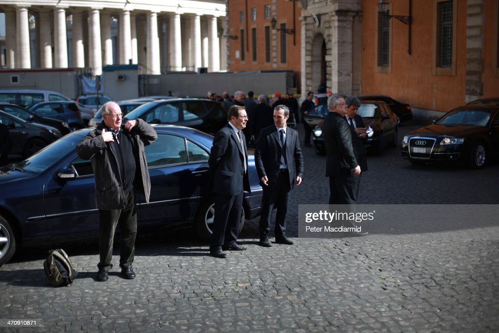 Drivers and security officials wait for the finish the Extraordinary Consistory on February 21, 2014 in Vatican City, Vatican. Pope Francis will create 19 new cardinals in a ceremony tomorrow in St Peter's Basilica.