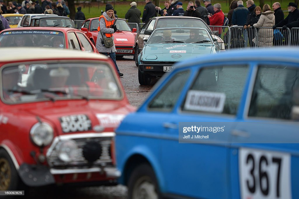 Drivers and their classic cars gather to leave Glasgow at the start of the Monte Carlo Classic Rally on January 26, 2013 in Glasgow. Around 100 cars set off from The People's Palace at Glasgow Green, they will pass through Kilmarnock and Dumfries on route to Monte Carlo via Dover.