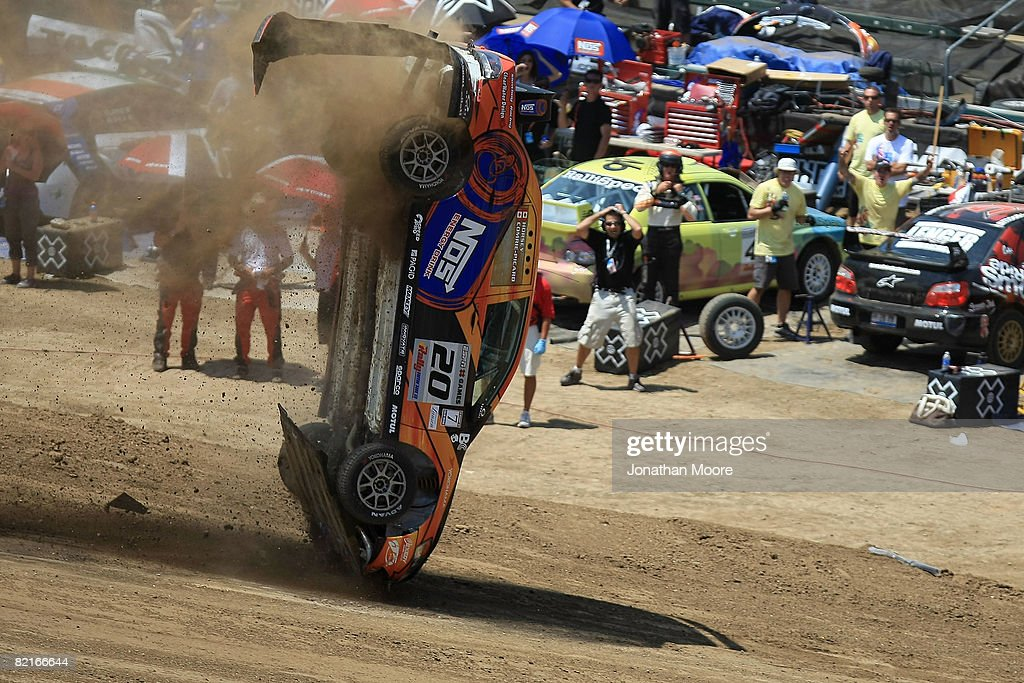 Drivers Andrew Comrie-Picard and Jen Horsey roll their car after the first jump during the Rally Car Racing Final at X Games 14 on August 3, 2008 at the Home Depot Center in Carson, California.