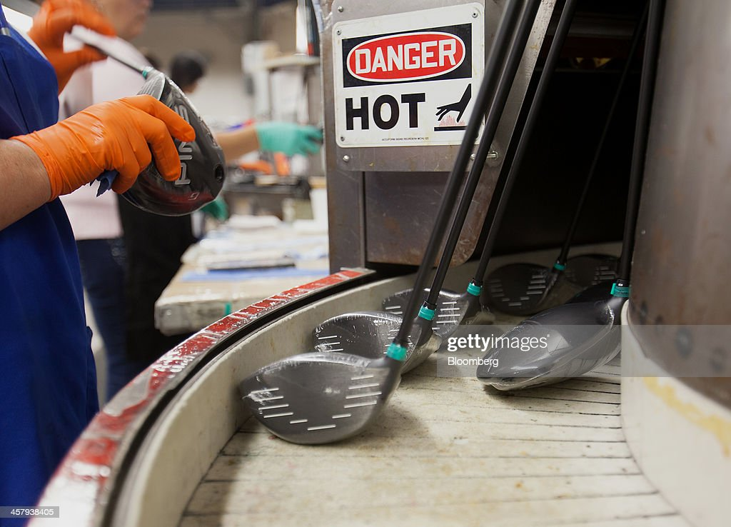 Drivers are heated in a custom oven to cure the epoxy used to join the head and shaft of each club at the Ping Inc. production facility in Phoenix, Arizona, U.S., on Tuesday, Dec. 17, 2013. The U.S. Census Bureau is scheduled to release durable goods figures on Dec. 24, 2013. Photographer: Tim Rue/Bloomberg via Getty Images