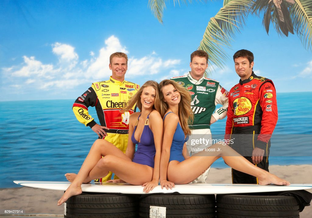 NASCAR drivers Clint Bowyer (33), Dale Earnhardt Jr. (88), and Martin Truex Jr. (1) are photographed with Sports Illustated swimsuit models Brooklyn Decker and Julie Henderson for USA Weekend on October 10, 2008 in Charlotte, North Carolina.