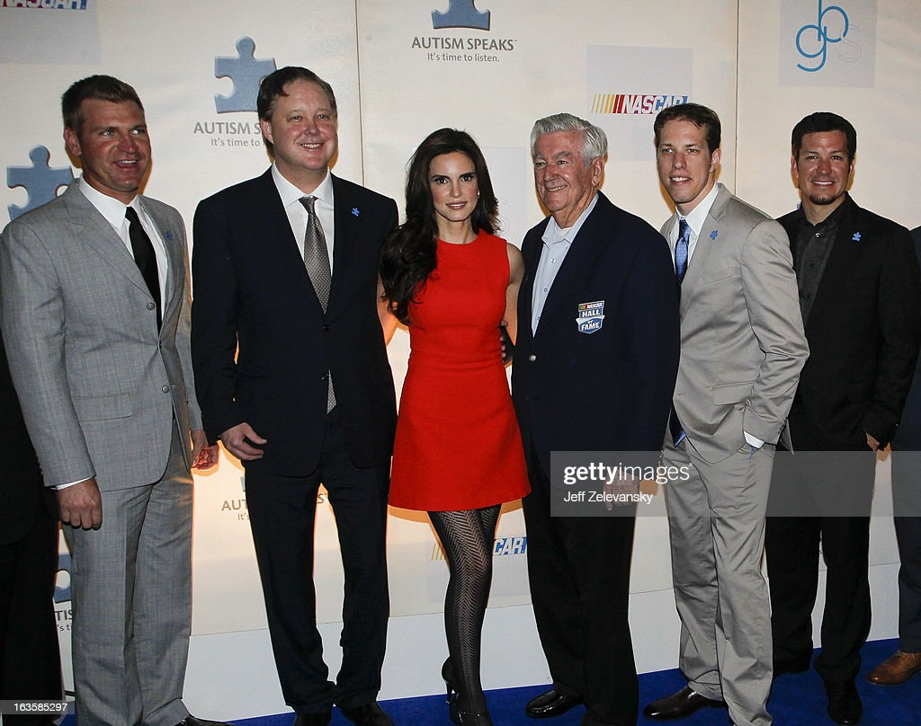 NASCAR drivers Clint Bowyer (L) join NASCAR Chairman and CEO Brian France, wife Amy, Hall of Famer Bobby Allison and drivers Brad Keselowski and Martin Truex, Jr. at 'Speeding For A Cure', a gala to benefit Autism Speaks held at the Metropolitan Museum of Art on March 12, 2013 in New York City.