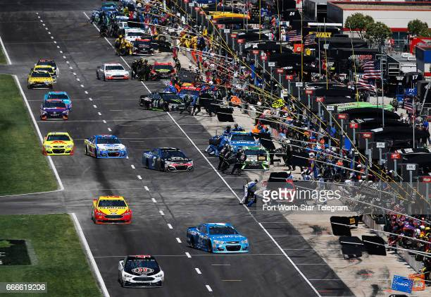 NASCAR drivers come into pit road for service during the O'Reilly Auto Parts 500 on Sunday April 9 2017 at Texas Motor Speedway in Fort Worth Texas