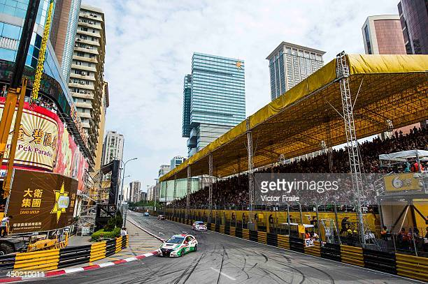 Drivers compete at the Lisboa turn during the FIA World Touring Car Championship as part of the 60th Macau Grand Prix on November 17 2013 in Macau...