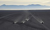 Drivers compete during 2015 Dakar Rally stage 8 between Uyuni Bolivia and Iquique Chile on January 11 2015 The Uyuni salt flat is the lasrgest in the...