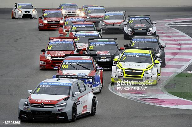 Drivers compete during the first race of the FIA World Touring Car Championship on April 20 2014 in Le Castellet southern France AFP PHOTO / FRANCK...