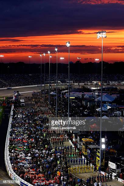 Drivers crewmembers and fans line the grid during prerace ceremonies prior to the NASCAR Sprint Cup Series Federated Auto Parts 400 at Richmond...