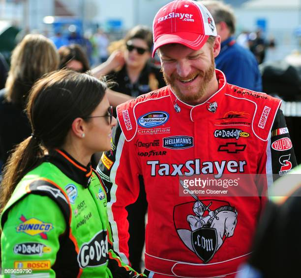 NASCAR drivers Danica Patrick and Dale Earnhardt Jr talk following their qualifying laps for the DRIVE4COPD 300 at Daytona International Speedway on...
