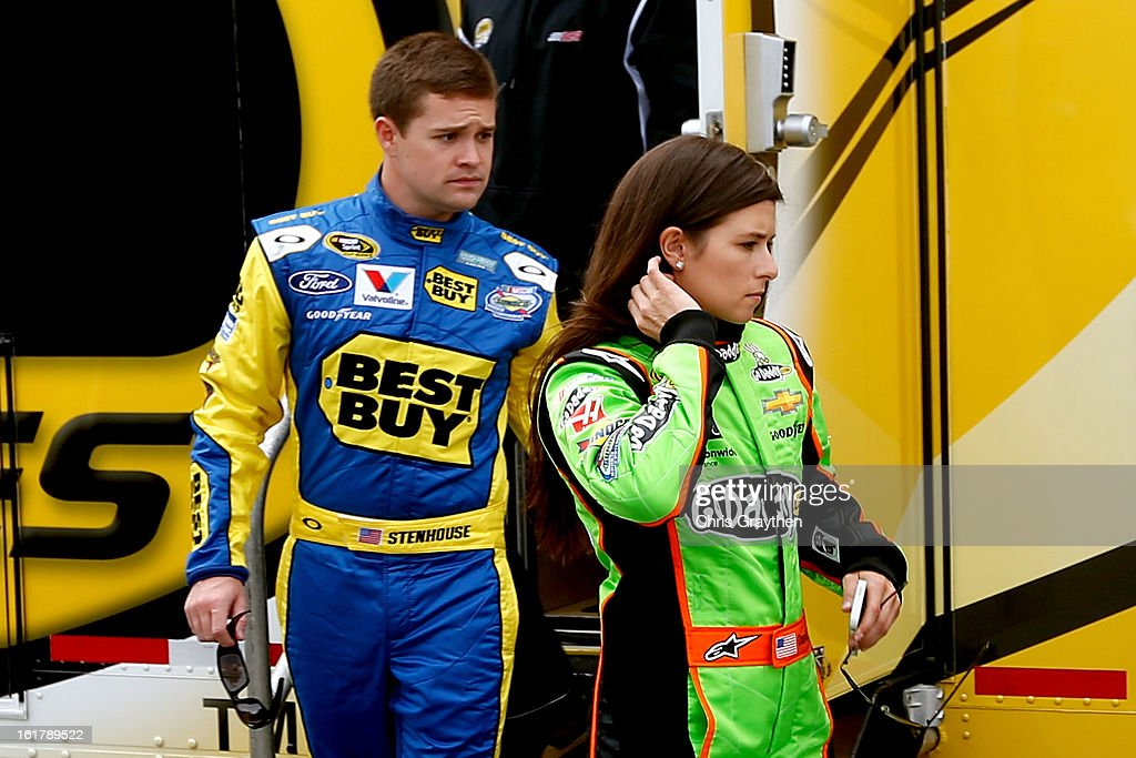 Drivers Danica Patrick and Ricky Stenhouse Jr. leave a rookie meeting prior to practice for the NASCAR Sprint Cup Series Sprint Unlimited at Daytona International Speedway on February 16, 2013 in Daytona Beach, Florida.