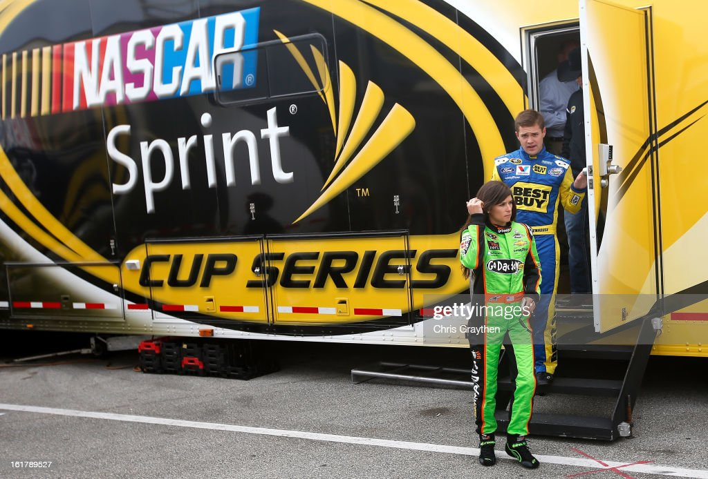 Drivers <a gi-track='captionPersonalityLinkClicked' href=/galleries/search?phrase=Danica+Patrick&family=editorial&specificpeople=183352 ng-click='$event.stopPropagation()'>Danica Patrick</a> and <a gi-track='captionPersonalityLinkClicked' href=/galleries/search?phrase=Ricky+Stenhouse+Jr.&family=editorial&specificpeople=5380612 ng-click='$event.stopPropagation()'>Ricky Stenhouse Jr.</a> leave a rookie meeting prior to practice for the NASCAR Sprint Cup Series Sprint Unlimited at Daytona International Speedway on February 16, 2013 in Daytona Beach, Florida.