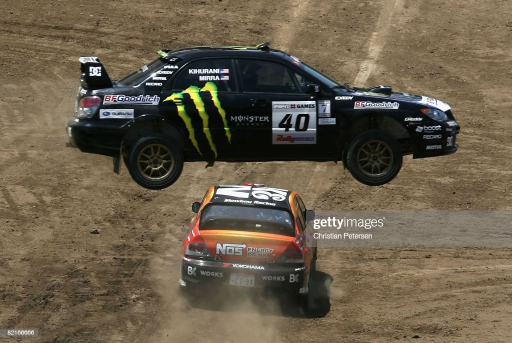 Drivers Dave Mirra and Alexander Kihurani jump over Andrew Comrie-Picard and Jen Horsey in the Rally Car race during the summer X Games 14 at Home Depot Center on August 3, 2008 in Carson, California.